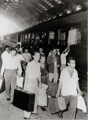 Italy, 50's. The picture shows a group of Italian emigrants leaving for Belgium in a train station.