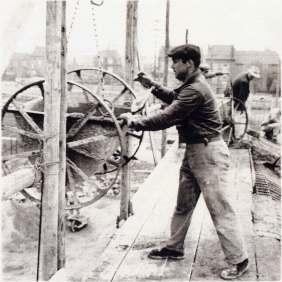Italians bricklayers during the building of the main tribune of Kennedy's stadium. Luxemburg, Dudelange, 1953.