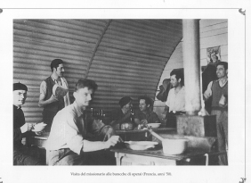 Missionary visiting the worker's shacks.France 1950. MBCA-Central Office for Library Heritage and Cultural Institutes, CSER, a suitcase full of America. Rome, The Hieroglyphics, 1992
