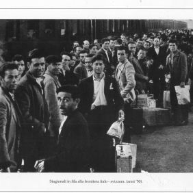 Seasonal workers standing in line at the Italian-Swiss frontier. Switzerland 1950 MBCA-Central Office for Library Heritage and Cultural Institutes, CSER, a suitcase full of America. Rome, The Hieroglyphics, 1992