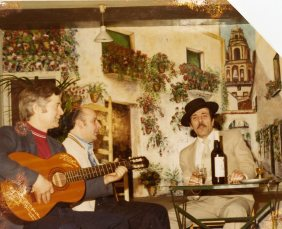 """At the association """"Arte y Cultura de Andalucia"""", on the right Manuel Ramirez, founder and president, on the left Luis Navarro, and holding a guitar Paco from Seville. Brussels 1982"""