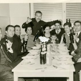 Manuel Mesa Lopez with his family and colleagues in the residence of the Claas factory on new year's eve in 1965. Hersenwinkel. Germany.