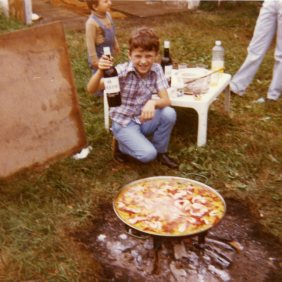 The son Custodio during a party in the countryside. Germany