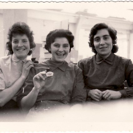 Annamaria Infanti with colleagues, workers at Pelikan, show some ink bottles.1959