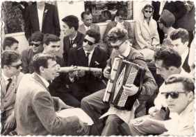 Feruglio Luigino plays the accordion during a trip on Lake Constance with work colleagues.1960