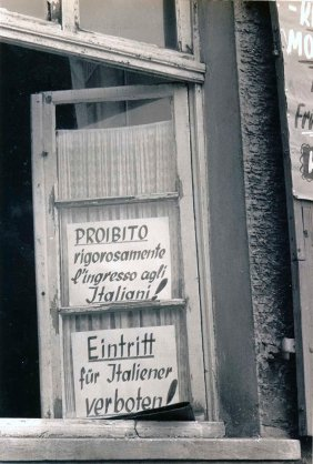 "The sign ""Prohibited strictly entry Italians"" posted at the entrance of a bar following some fights starring Italian immigrants. Saarbruecken 1955/56"